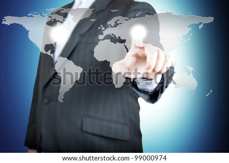 Business man pointing on the touch screen with world map. Concept for connectivity