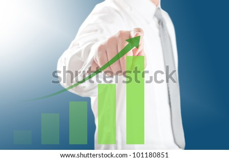 Business man pointing rising chart