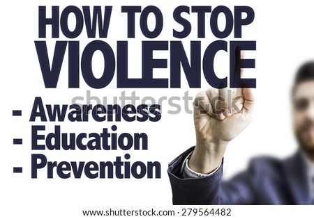 Business man pointing the text: How to Stop Violence