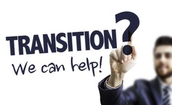 Business Man Pointing the Text: Transition? We Can Help!