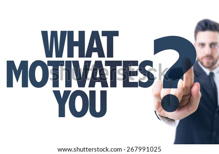 Business man pointing the text: What Motivates You?