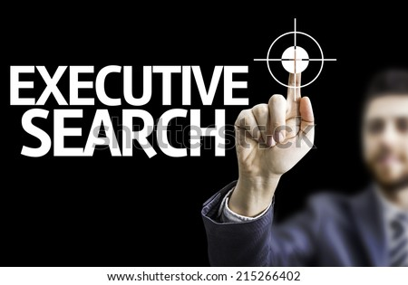 Business man pointing to black board with text: Executive Search