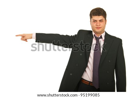 Business man pointing to left part of image isolated on white background - stock photo