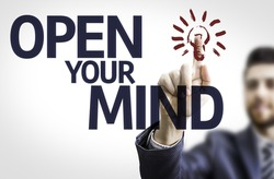Business man pointing to transparent board with text: Open your Mind