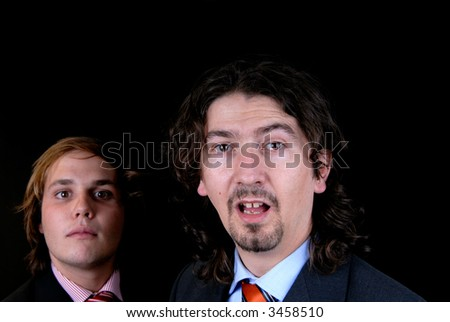 business man portrait isolated on black background, focus on the right man