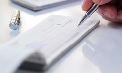 Business man prepare writing a check