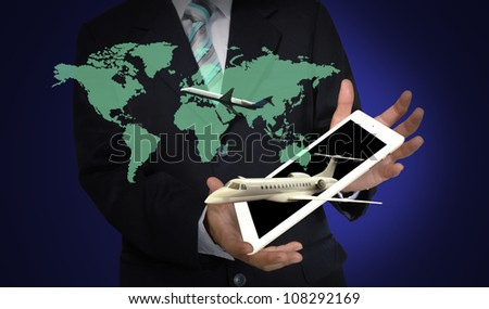 Business Man present flight trip around the world over tablet PC.