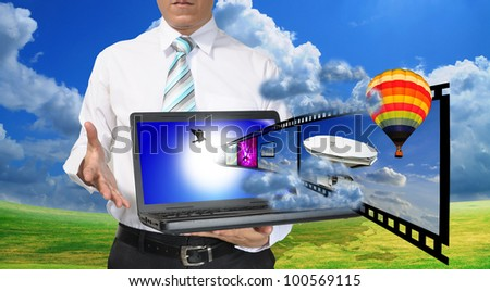 Business Man present laptop with streaming video or filmstrip