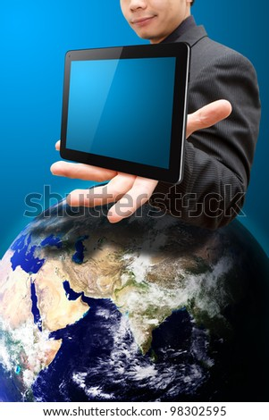 Business man present the Tablet PC : Elements of this image furnished by NASA