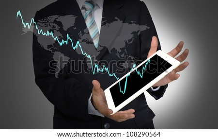 Business Man present world graph with tablet PC
