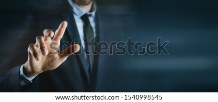 business man presses on touch screen #1540998545