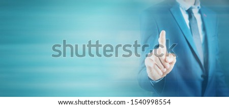 business man presses on touch screen #1540998554
