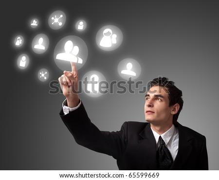 business man pressing a digital button