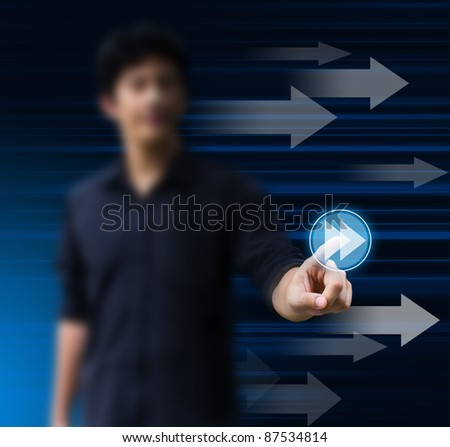 business man pressing a fast forward button - stock photo