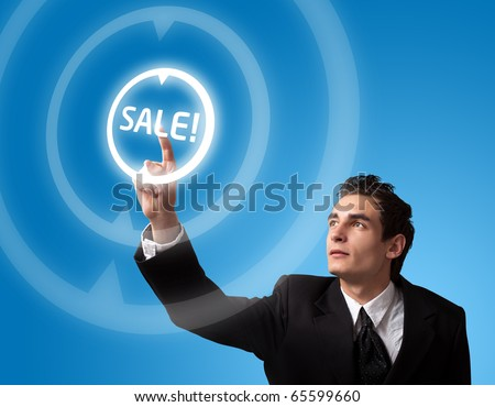business man pressing a SALE button - stock photo