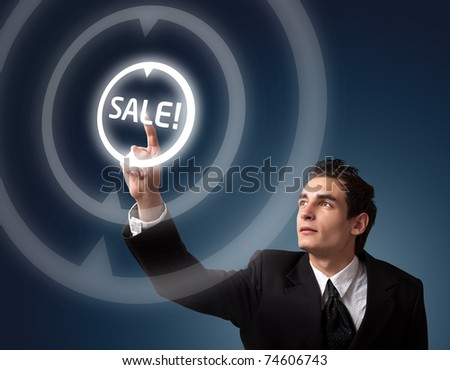 business man pressing a SALE button
