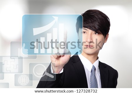 Business man pressing a touch screen button with all kinds of business icon isolated on gray background, asian model