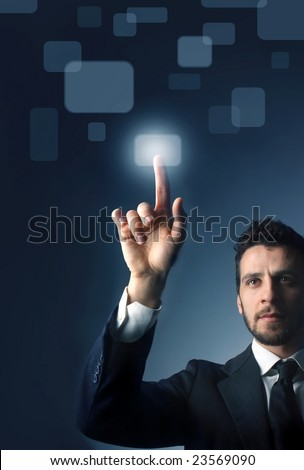 business man pressing a touchscreen button - stock photo