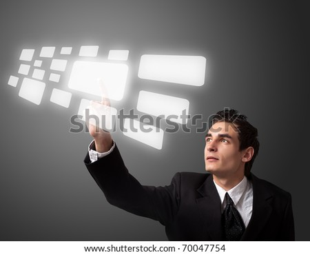 Business man pressing a touchscreen button.