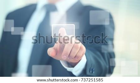 business man pressing a touchscreen button #737251585