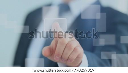 business man pressing a touchscreen button #770259319