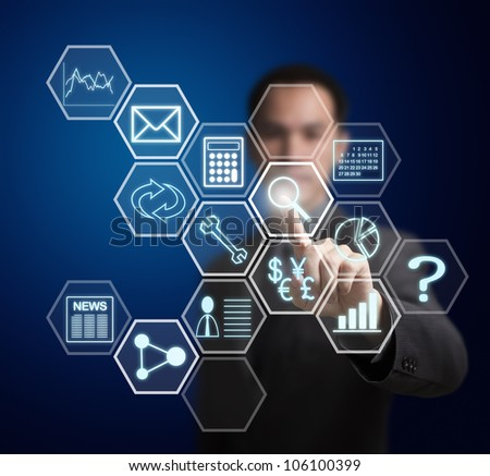 business man pressing application button on computer touchscreen - stock photo