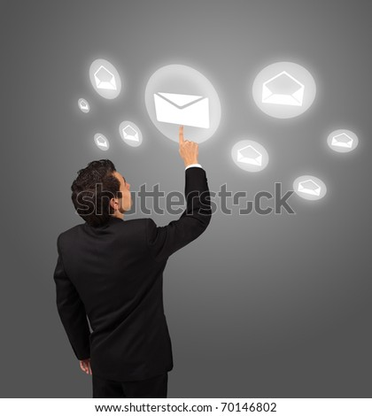 business man pressing e-mail button