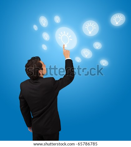 business man pressing lightbulp button