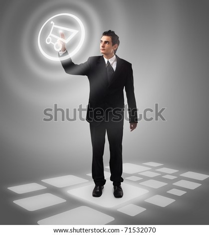 Business man pressing  shopping cart button, futuristic digital technology