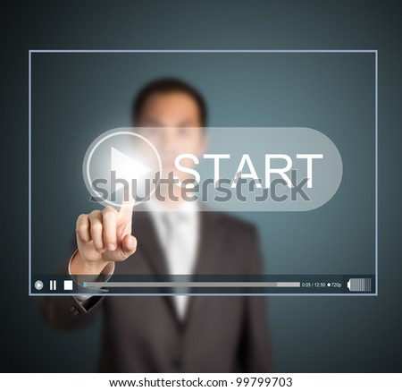 business man pressing start button to play video clip
