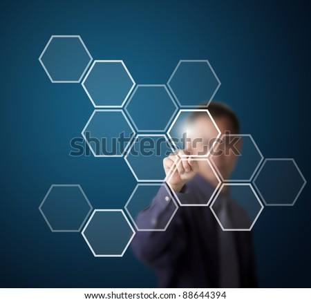 business man push a hexagonal touch screen button