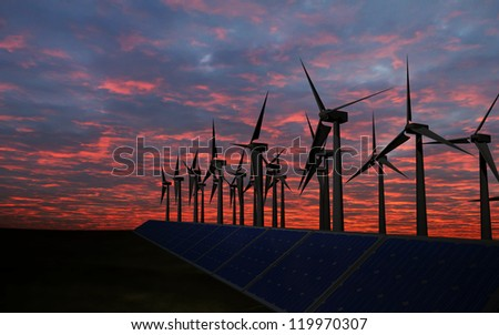business man push power button,  Panels with solar cells and wind generators on a green field with blue sky