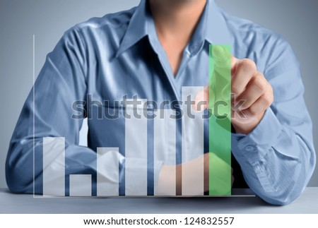 Business man pushing a graph