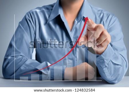 Business man pushing a graph