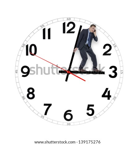 Business man pushing clock running out of time