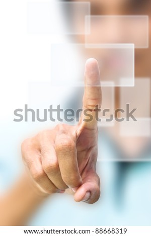 Business man pushing on touch screen icon