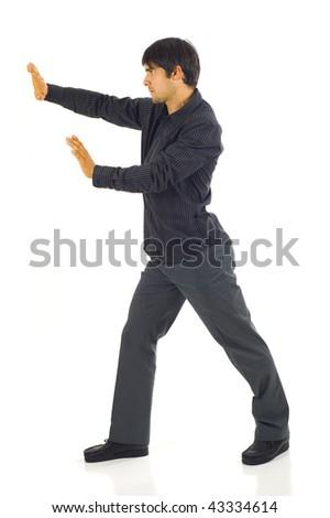 Business man pushing something imaginary isolated on white
