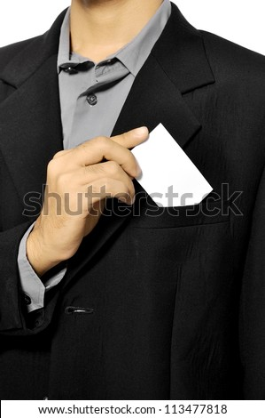 Business man putting a blank business card in his suit pocket