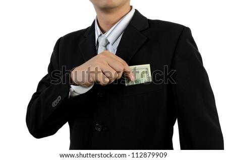 Business man putting money into pocket