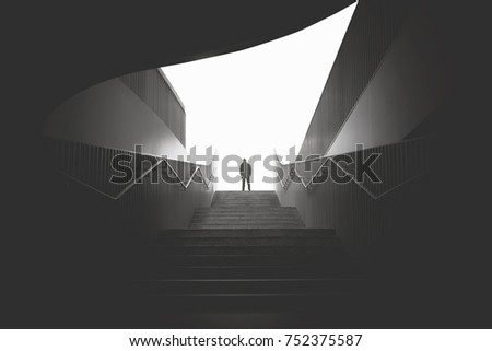 business man raising stairs to reach the city - Shutterstock ID 752375587