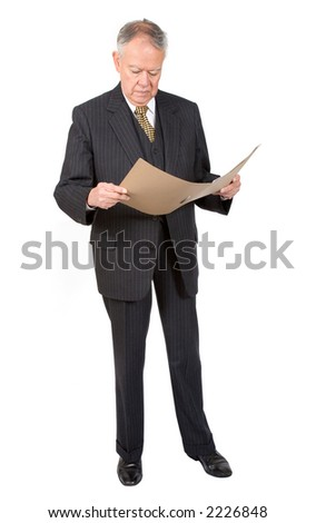 business man reading a report over white