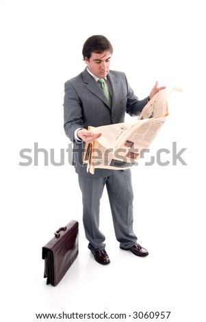 Business man reading business section of newspaper on white background