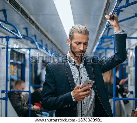 business man reading his e-mail correspondence in the subway. Сток-фото ©