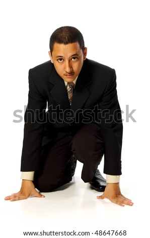 Business man ready to run isolated on white background