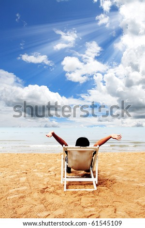Business man relax on deck at the beach