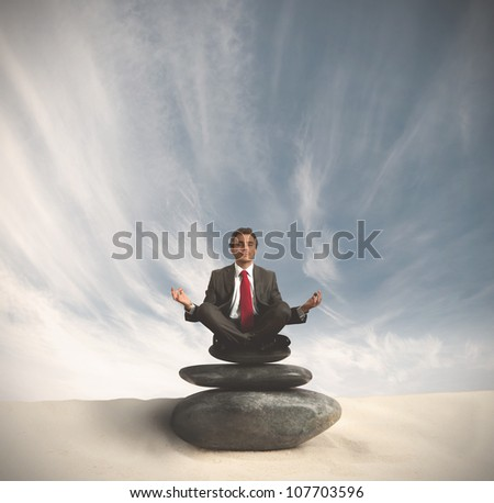 Business man relaxes on the stones spa