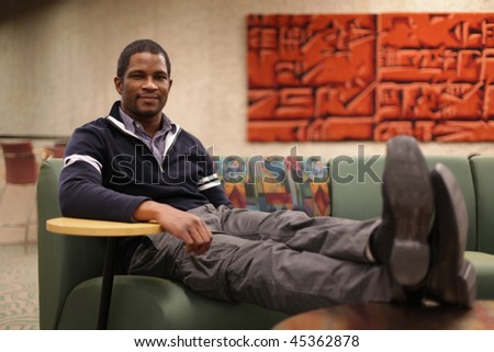 Business Man relaxing with feet up