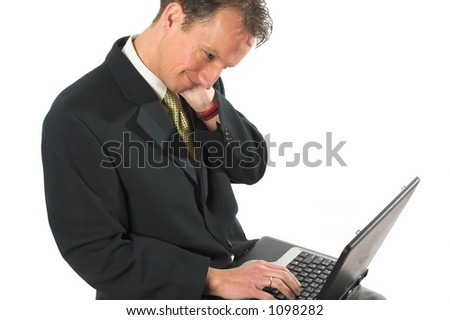 Business man rubbing his neck after having worked at the computer for too long