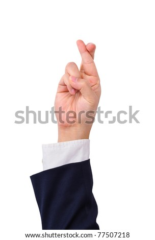 Business man's finger crossed hand sign isolated on white