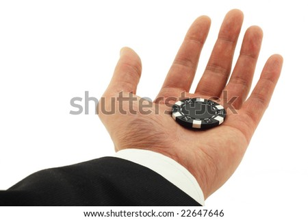 Business man's hand holding a casino chip isolated on white